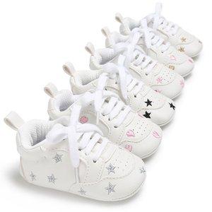 PU estrellas Spring deportes y otoño los nuevos hombres y mujeres bebé muchachas de los bebés calza los zapatos antideslizantes de los niños inferiores suaves