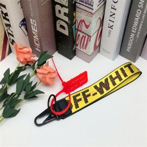 off canvas mobile phone key chain European and American tide brand jeans with wrist camera pendant white belt