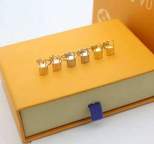 Fashion joker design foreign trade jewelry hot style titanium v lock earrings 18k gold stud earrings for men and women