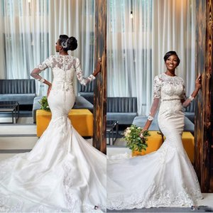 2020 African Plus Size Mermaid Wedding Dresses Long Sleeves Lace Appliqued Crystal Beaded Sweep Train Wedding Gowns Robe De Mariee