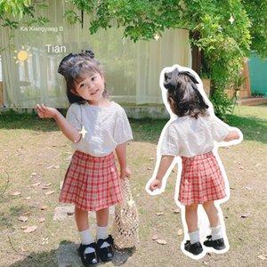 infantiles Zhili ropa 2020 muchachas del estilo de Corea del verano del color puro ropa de la muñeca bebé camisa de la tapa del bebé Top camisa de la muñeca de las mujeres