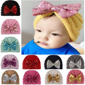 2020 Accessoires bébé Vêtements pour bébé bébé garçon Bonnet hiver bowknot chaud Cap Crochet Tricoté Sequin Bow Hat Caps Turban