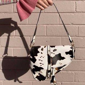Motif de vache rétro sac à bandoulière en cuir PU Femmes Sac Aisselle Conception avancée de Crossbody selle shopping les filles sac à main Bolso