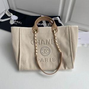 I nuovi differisce qualità Pearl Beach bag 7A high-end personalizzato da quello vecchio a che la decorazione perla è più atmosfera di fascia alta