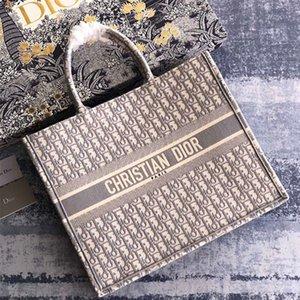 La nuova alta capacità Tote bag qualità 7A high-end personalizzato è fatta di tela ricamato grigio con vari modelli e colori