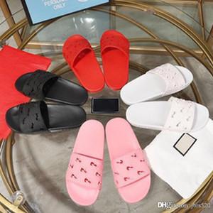 Sommer-Mode Letters Frau Strand Pantoffeln Luxus-Leder-Cartoon Big Head Slippers Designer flachen Hohl Hotels Bad Männer Pantoffeln 35-45