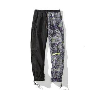 EWQ   men's clothing 2020 Tide niche patchwork Asymmetric Printing Men's casual Trousers autumn fashion new pants 19H-a306