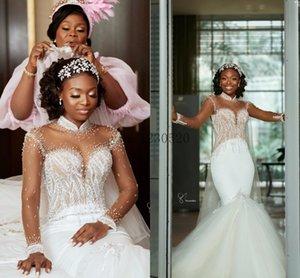Luxury Crystal Mermaid Wedding Dresses High Neck Long Sleeve Sweep Train Illusion Bodice Beads Garden Chapel Bridal Gowns vestidos de novia