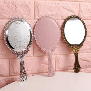 High Definition mão que olha Retro Vidro Padrão Vanity iluminado maquiagem espelho coreano estilo princesa Compact Mirrors Handle portátil 2 2JF B2