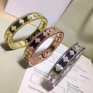 Nuevo diseño de 1,0 cm de anchura superior calidad de los materiales de cobre del brazalete de amor punk con el trébol y diamante para las mujeres en 5.9 * 4.9cm de la joyería PS5243