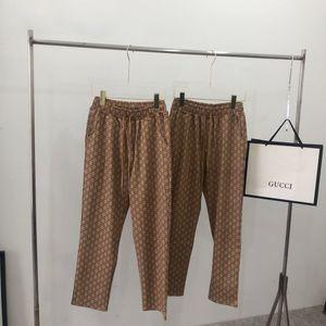 20SS Новый роскошный дизайнерский бренд GC ретро Полная печать эластичный пояс брюки Мужчины Женщины моды спорта Jogger Sweatpants Открытый Брюки 7.17