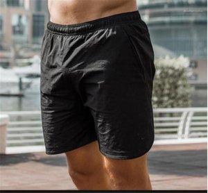 Повседневный Running тренировочные брюки конструктора Mens спорта на открытом воздухе Короткие летние мужские быстрое высыхание сплошной цвет Zip Карманы шорты Новые