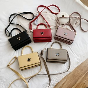S4YLe 2020 new Postman package postman package French niche exquisite triangle lock fashionable portable women's bag Korean women's messenge