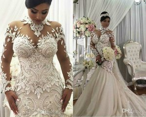 Plus Size Illusion Long Sleeve Mermaid Wedding Dresses High Neck Appliqued Beaded Dubai Arabic Bridal Gown Long Castle Wedding Gown
