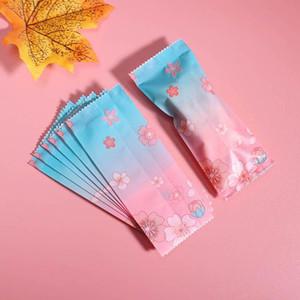 500pcs / lot Nougat Sac d'emballage bleu rose romantique Plum Party bricolage à la main en plastique bonbons Emballage Sac lait Taffy bonbons Wrapper