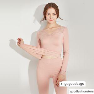 19 lace warm suit women's winter hollow autumn clothes Qiu Ku traceless mesh sexy two-piece set t781