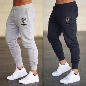los hombres pantalones de chándal pantalones de diseño corredores deportivos gimnasios de fitness Thin Pantalón ajustado de elasticidad pantalones de carga Hombres corrientes Letter Pantalones de impresión