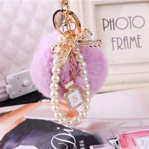2020 الأزياء اللؤلؤ سلسلة كريستال زجاجة القوس بوموم المفاتيح سيارة المرأة حقيبة مفتاح سلسلة حلقة رقيق النفخة الكرة مجوهرات
