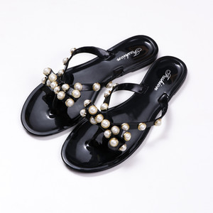 Cross-border hot style bow pearl flip-flop female summer foreign trade non-slip rivet crystal slippers female