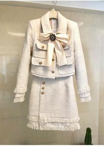Марка Lady Wool 2 Piece Set 2020 Зимних Женщины Алмазного лука Золото однобортного Короткие Твида куртка пальто + юбка-карандаш кисточки Костюм