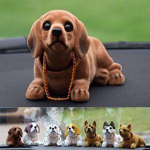 Funny Car Dashboard Doll Nodding Dog Scuotere la testa di simulazione resina Dog Car Toy Ornamento sveglie Accessori Bambina Donna Uomo