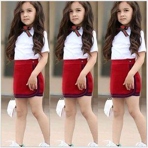 귀여운 여름 여자 유니폼 의류 세트 활 꽃 넥타이 탑스 티셔츠 + 짧은 미니 스커트 2pcs 세트 아이 복장 소녀 정장 1-5 년