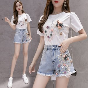 2020 Korean version of the hole three-dimensional flower high waist large size denim shorts