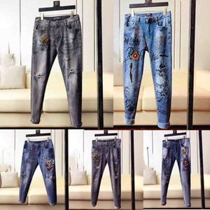 2020 High quality mens designer jeans Distressed Motorcycle skinny jeans Slim Ripped hole stripe Fashionable snake embroidery Denim pants