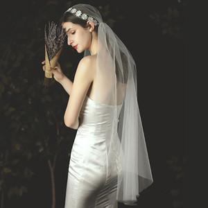 Lunghezza delle dita di ispirazione vintage perla in rilievo Motivo floreale merletto puro Giulietta Cap Wedding Bridal Veil Donne Accessori Copricapo