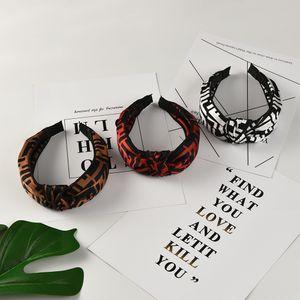 Ampia lettera Inglese fascia del cerchio dei capelli per le donne superiori di modo ha annodato il hairband del panno morbido di usura testa accessori per capelli elastico con testa a croce