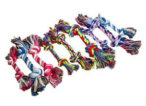 Mascotas Perros de alimentos para mascotas Pet Puppy Dog Chew algodón nudo juguete durable cuerda trenzada Bone 18cm divertido herramienta de color al azar
