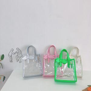 2020 children's Hand hand hand cute wings five-pointed star girl messenger bag Korean Children's transparent beach bag