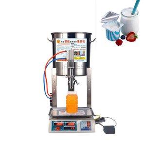 CE automatique machine de remplissage liquide petit lait huile de machine miel de remplissage du miel domestique de sésame pesant machi de remplissage quantitative