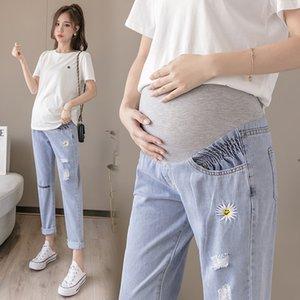 2020 ayuda del vientre de gran tamaño del agujero suelta fina nueva ropa de maternidad del verano margarita maternidad jeans y pantalones jeans bordados papá
