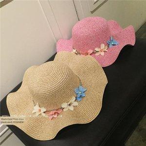 Mujer paja matriz verano flor de la mariposa de paja sombrero de playa del bowknot de la marea sombrero para el sol junto al mar borde ondulado fiestas para niños