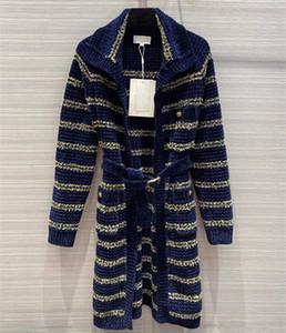 Port des femmes européennes et américaines 2020 hiver nouveau revers à manches longues avec fil d'or et manteau de cardigan en tricot à rayures
