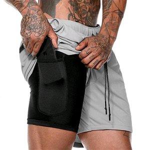 GYM ПОБЕДИТЕЛЬ Gym шорты бегущих шорт Двухэтажный сжатий Mens Fitness Bodybuilding дышащих шорты быстрого высыхание MX200815