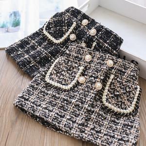 INS encanto faldas de las muchachas niños otoño invierno Moda Faldas de lana de perlas cortos faldas A-Line muchachas de la falda lápiz ropa 2-7T
