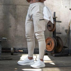 Pantalones para hombre del basculador de deportes de la moda flaco Pantalones deportivos diseño de la cremallera pantalón hombre gimnasios Fitness Workout algodón Pantalón masculino
