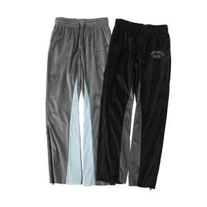 Cremallera lateral de terciopelo pantalones ocasionales de los hombres y mujeres del remiendo del cordón de terciopelo Carta Pantalones Pantalones deportivos