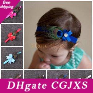 10pcs Baby-Pfau-Feder-Bogen-Blumen-Stirnband für Mädchen-Haar-Zusatz-Kleinkind-Bögen mit Strass Haarreif Newborn Foto Prop Ym6103