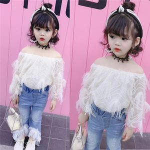 2020 new two-piece set of new suspenders jeans hole stitching fishing net set white shoulder + inverted V hole bell bottom suit