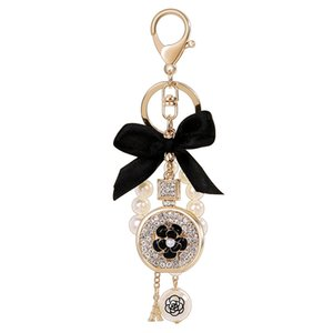 New creative bow crystal perfume bottle keychain Pearl car key ring Female bag pendant accessories Charm jewelry keychain