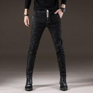 El otoño y el invierno con cordones de los hombres jóvenes estiramiento delgado coreano, simple negro y pantalones vaqueros pantalones vaqueros flacos tienda online
