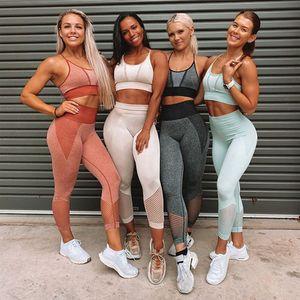 Sin costuras elásticas Entrenamiento Traje Mujeres sólido sujetador y la altura de la cintura polainas conjunto de yoga gym hembra del basculador Set Trajes