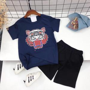 Moda para niños Trajes Niños Niñas tigre de impresión de dos piezas sistemas de los niños de la camiseta + shorts 2020 sistemas ocasionales más el tamaño de sistemas de la ropa