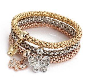 3pcs / set Elastic Kristall-Armband Diamant-Herz-Kronen-Baum des Leben Schädel-Schmetterlings-Charme-Armband-Armband-Stulpe-Sets Schmuck