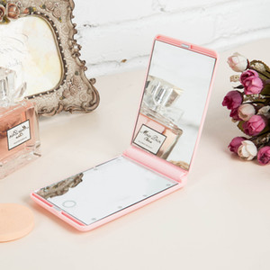 Hot Selling Customizable Portable Vanity Mirror Hand Pocket Magic Makeup Mirror with LED Light