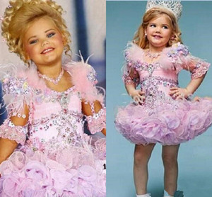 Lovely Eden Wood Pink Baby Toddler Pageant Dresses For Girls Glitz Rhinestones Ball Gown Pink Feathered Kids Party Dresses