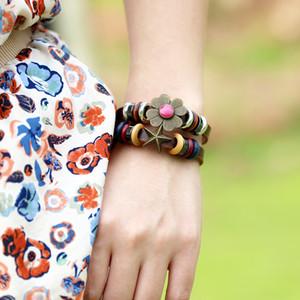 dankaishi Echtlederband Armband für Frauen Metall Blume und Stern-Charme-elegante Art Boho Schmuck Travel-Verpflichtungs-Geschenk
